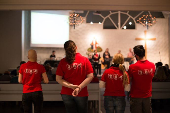 Sweden: Omers wear their distinct red pray give go shirts at a missions focused conference in Sweden where they hope to inspire, recruit, and bless people More Info