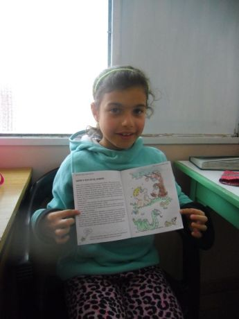 Argentina: One of the girls from the Childrens home proudly displays her completed colouring book. More Info
