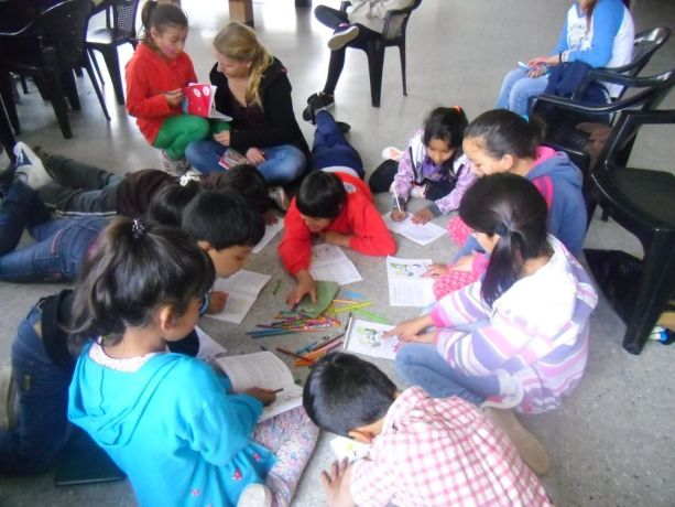 Argentina: Two team members lead an activity teaching Bible stories through colouring with kids at a local Childrens home More Info