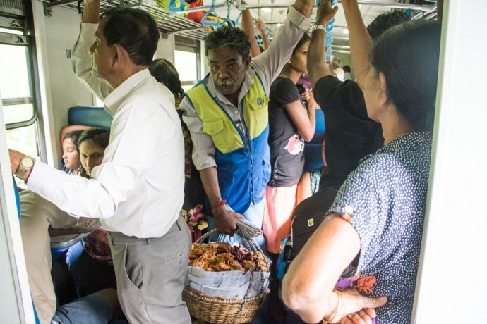 Sri Lanka: Colombo, Sri Lanka :: A man selling food on the train. More Info