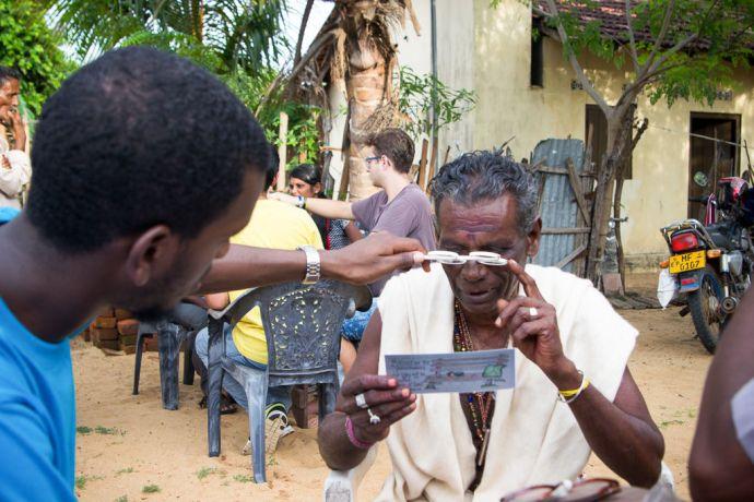 Sri Lanka: Colombo, Sri Lanka :: A team member from Logos Hope tests the eyesight of a local person before providing reading glasses.  More Info