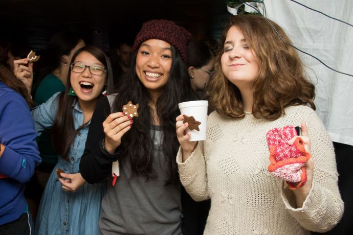 Mauritius: At Sea :: Crewmembers enjoy cookies and fellowship at the German Market after the European/North America Advent Sunday Service in the Logos Lounge. More Info