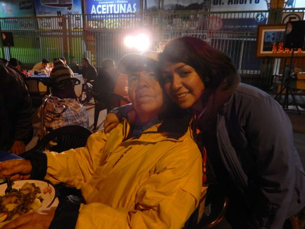 Chile: Meal of Love, October 2015. Volunteer spending time with a homeless guy. More Info