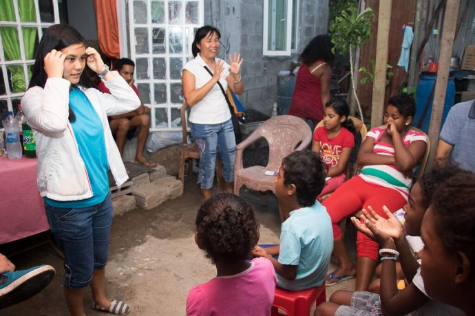 Mauritius: Port Louis, Mauritius :: Ivy Chiu (Taiwan) tells a story to the children in a house church after visiting homes in the village. More Info