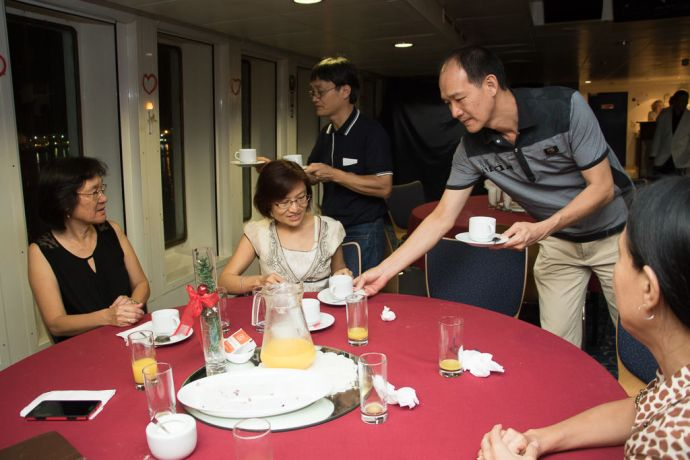 Mauritius: Port Louis, Mauritius :: The men serve their wives at an event on board for couples in the Logos Lounge. More Info