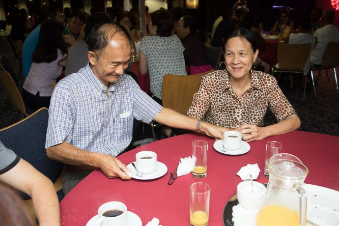 Mauritius: Port Louis, Mauritius :: A man serves his wife at an event on board for couples in the Logos Lounge. More Info