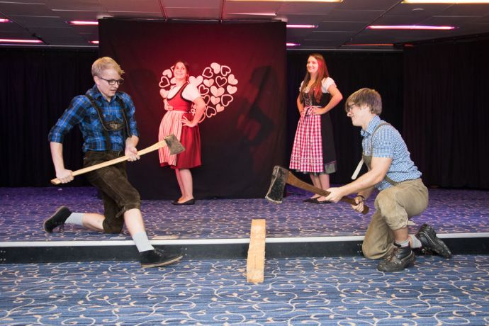 Mauritius: Port Louis, Mauritius :: Constantin Wolf (Germany), Fanny Pouget (Algeria), Viola Muck (Germany) and Colyn Borlinghaus (Germany) perform the German Woodcutter dance at an event onboard in the Logos Lounge. More Info