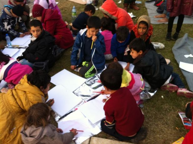 Serbia: Children of refugees traveling through Serbia sit on the ground enjoying art projects led by OM volunteers. More Info