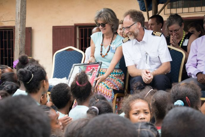 Madagascar: Toamasina, Madagascar :: Carla and Captain Ed Verbeek (Netherlands) show children a gift they received from the newly renovated city library at the official opening. More Info