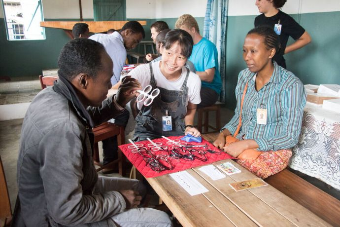 Madagascar: Toamasina, Madagascar :: Sharon Ong (Singapore) tests the eyes of an inmate at the city prison. More Info