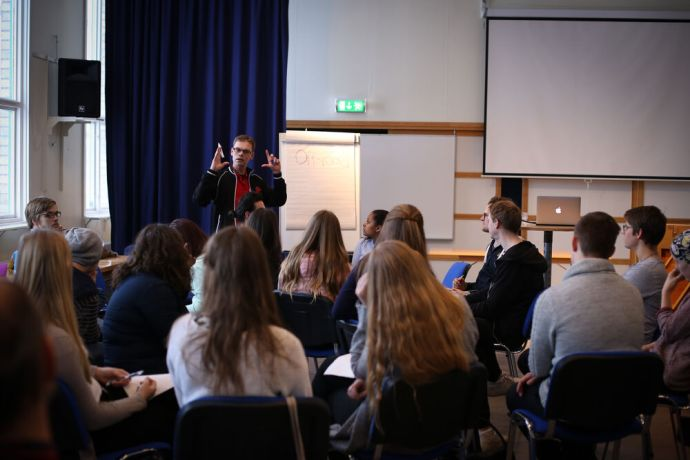 Sweden: OM Swedens field leader, Martin Strom, teaches teens a simple napkin diagram for sharing the gospel with their friends. More Info