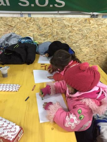 Serbia: Refugee children drawing in a camp in Serbia. More Info