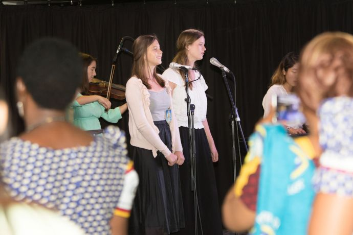 Tanzania: Dar es Salaam, Tanzania :: Femke Rutgers (Aruba) and Anna Bolte (Netherlands) sing at a pastors wives event in the Logos Lounge. More Info