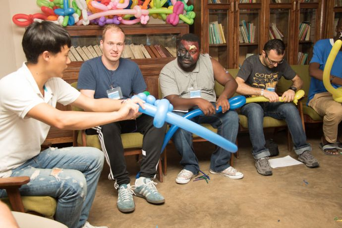 Tanzania: Dar es Salaam, Tanzania :: New Crew members learn how to create balloon shapes at pre-ship training. More Info