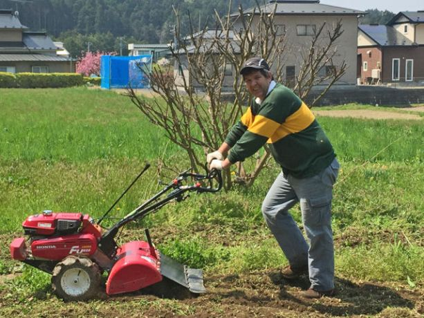 Japan: Stephan Smithdorff, OM Japan Miyagi teams leader, is working the ground in front of his house More Info