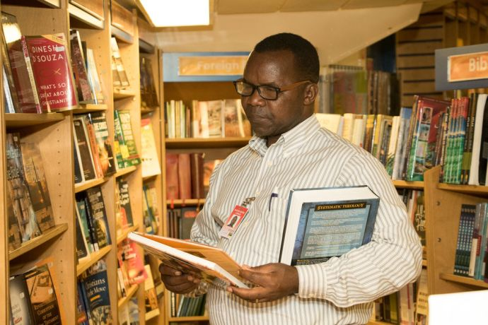 Mozambique: Maputo, Mozambique :: A pastor selects books in the bookfair after receiving a gift voucher. More Info