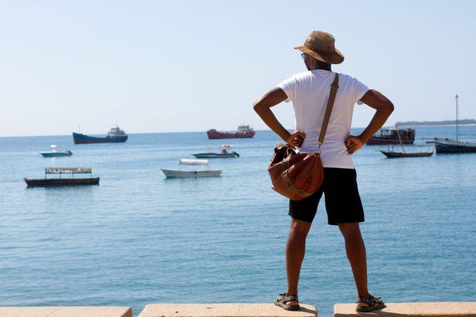 Tanzania: Kagiso looks across the water in Zanzibar, Tanzania More Info