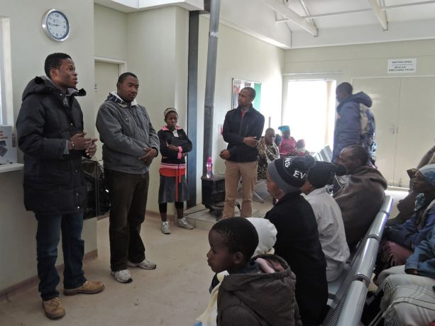 Lesotho: Mokhotlong, Lesotho :: Kapela Sibiya (South Africa - left) speaks with locals waiting at a clinic. More Info