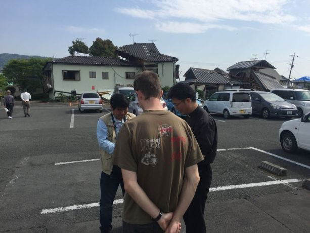 Japan: Praying with a local pastor in front of the collapsed East Kumamoto Bible Christ Church More Info