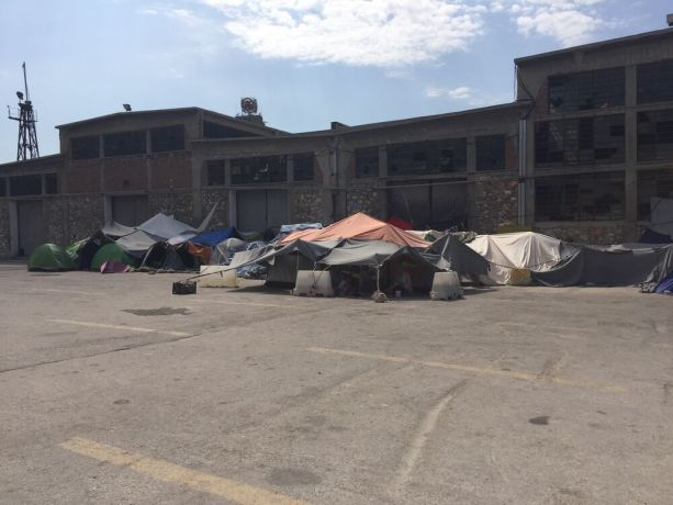 Greece: Tents where refugees are living in Piraeus Port in Athens, Greece More Info