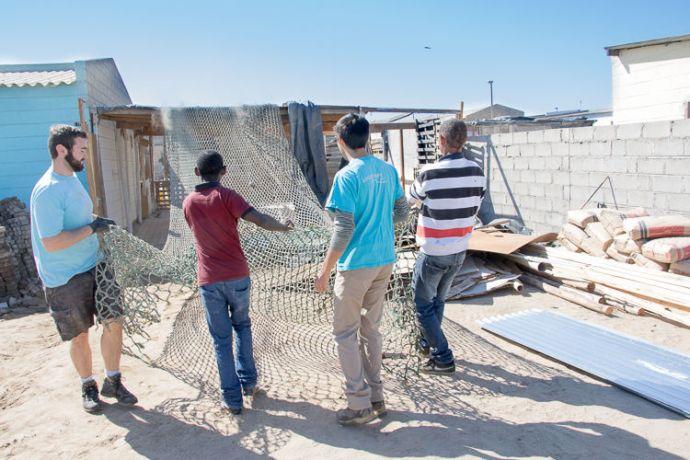 Namibia: Walvis Bay, Namibia :: Josh McArthur (UK) and Josiah Penner (Canada) help demolish a church to be rebuilt. More Info