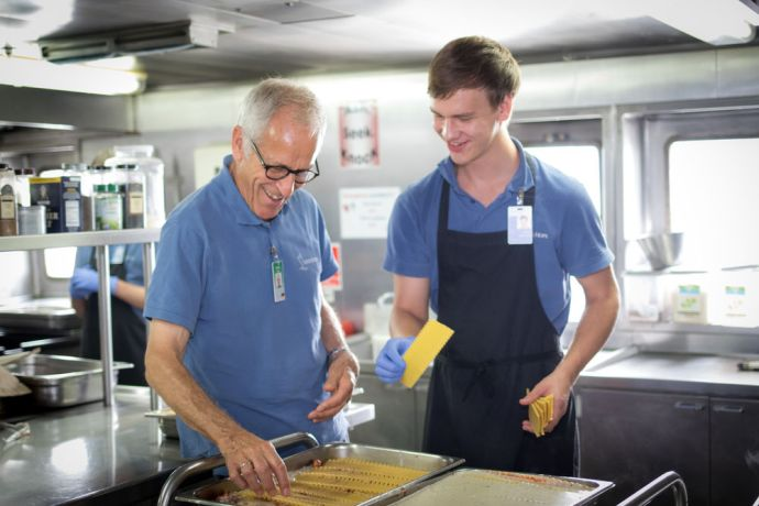 Cameroon: Douala, Cameroon :: Frieder Hils (Germany) and Daniel Satterly (Germany) prepare food for the crewmembers of Logos Hope. More Info
