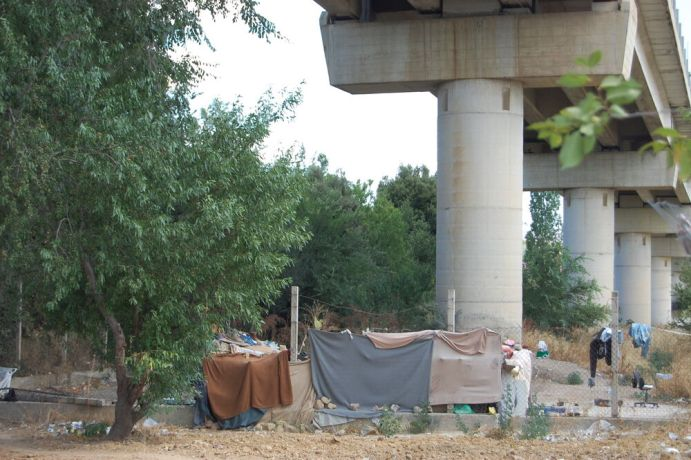 Italy: Refugees without asylum make their informal camp under a bridge, Sicily, Italy. More Info