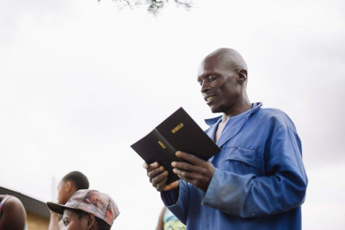 Lesotho: A Lesotho man reads publically from the Bible. More Info