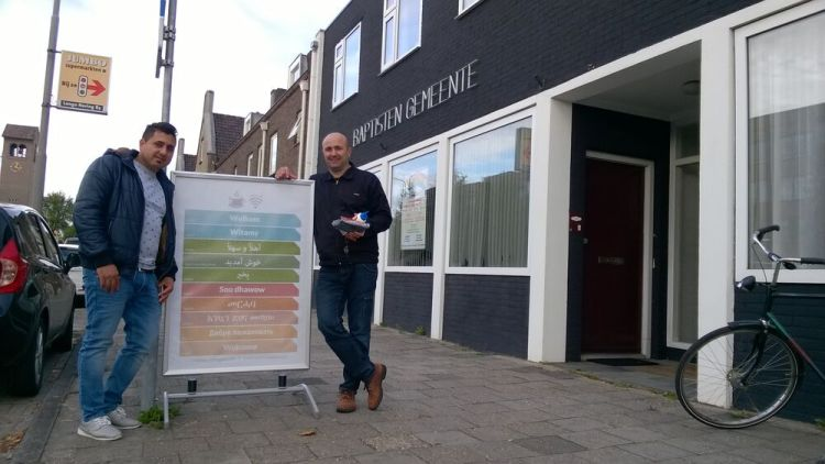 Netherlands: Two immigrant men pose outside of the Baptist church building in Emmeloord, where OM workers and church members organise a walk-in for immigrants every Tuesday afternoon. More Info