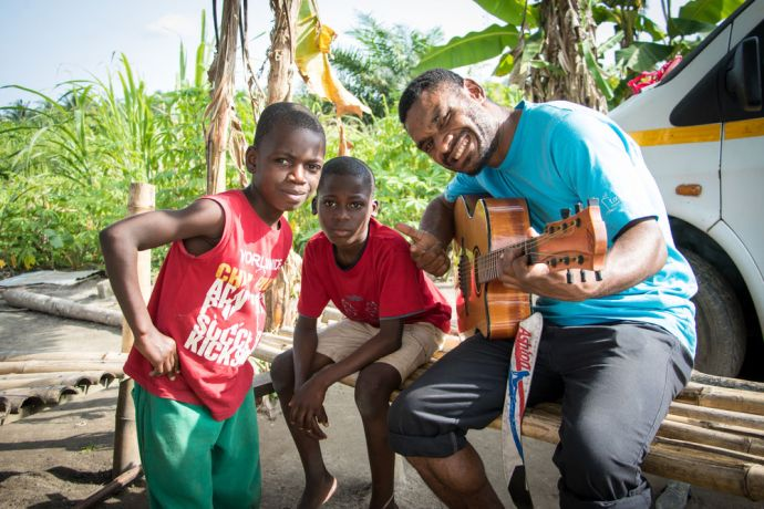 Ghana: Sekondi, Ghana :: Ofasia Wayne (PNG) plays the guitar for boys at Fathers Home Ministries orphanage. More Info
