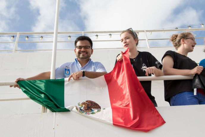 Cape Verde: Praia, Cape Verde :: Mehni Gonzalez (Mexico) flies his national flag as Logos Hope arrives in Cape Verde. More Info