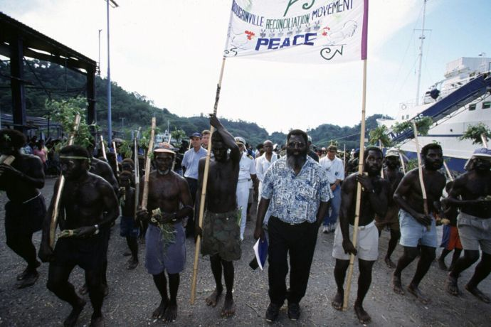 Ships: President Joseph Kabui in the procession to mark Bougainvilles reconciliation ceremony More Info