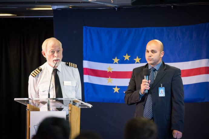 Cape Verde: Mindelo, Cape Verde :: Captain Chris Hughes (UK) and interpreter Flavio De Lima (Brazil) speak at official opening. More Info