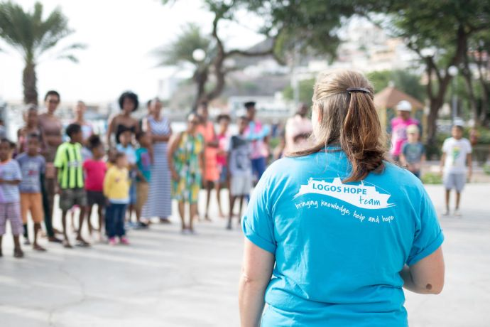 Cape Verde: Mindelo, Cape Verde :: Children and parents gather in a public square in Mindelo as a team from Logos Hope interacts with young people More Info