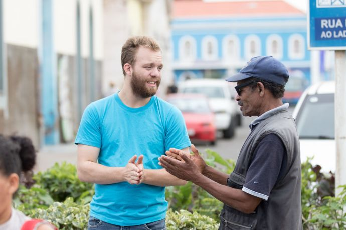 Cape Verde: Mindelo, Cape Verde :: Fridi Dam (Faroe Islands) shares hope with a man on the street. More Info