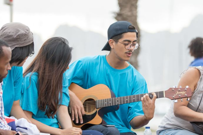 Cape Verde: Mindelo, Cape Verde :: Caio Konichi (Brazil) sings and plays the guitar in the streets for the people of Mindelo. More Info