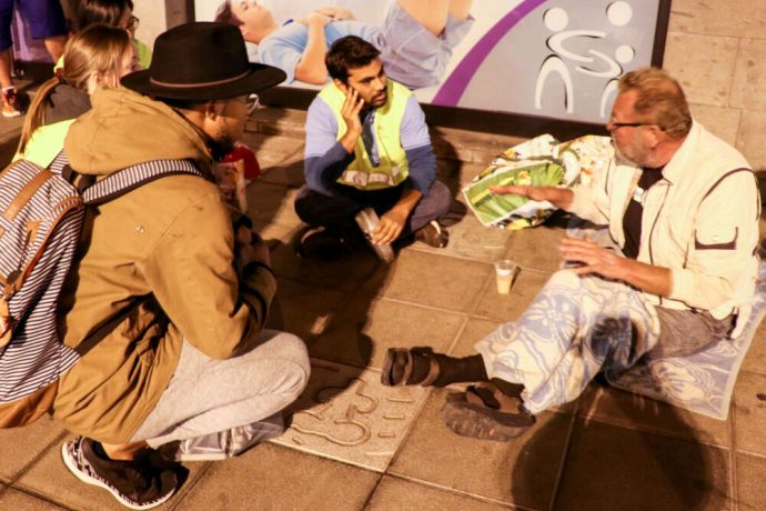 Spain: Las Palmas, Spain :: Crewmembers distribute sandwiches and coffee to people sleeping on the streets. More Info