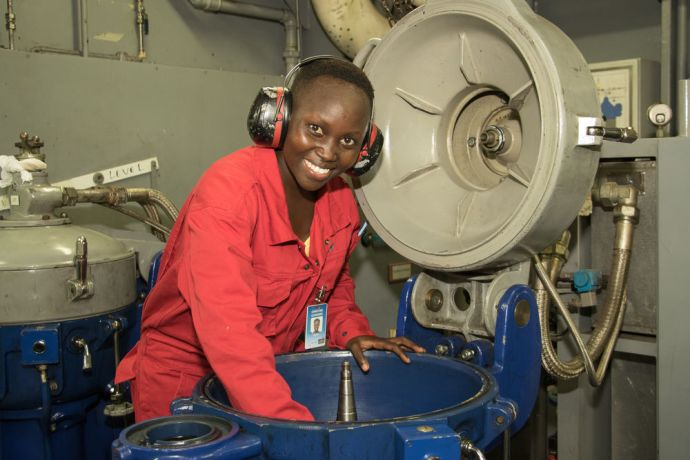 Ships: Maputo, Mozambique :: Christine Chongwo (Kenya) at work in Logos Hopes engine room. More Info