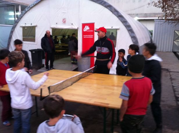 Serbia: an OMer teaches young refugee friends how to play table tennis More Info