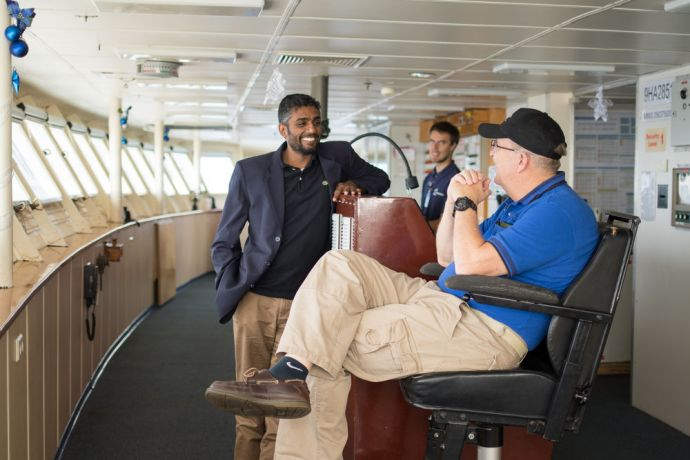 Ships: At Sea :: Logos Hope Captain Tom Dyer (USA) and Director Seelan Govender (South Africa) converse on the bridge. More Info