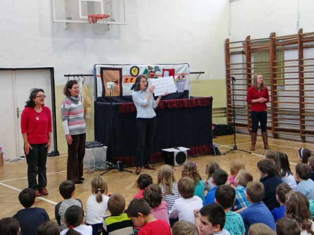 Hungary: The OM Hungary puppet ministry team leads schoolchildren in a song during the teams annual Christmas outreach. More Info
