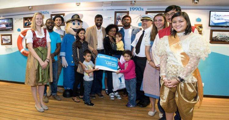 Guyana: Georgetown, Guyana :: The six millionth visitor, Sharmila De'Abreu, and her family (centre) are welcomed by leaders and crewmembers of Logos Hope. More Info