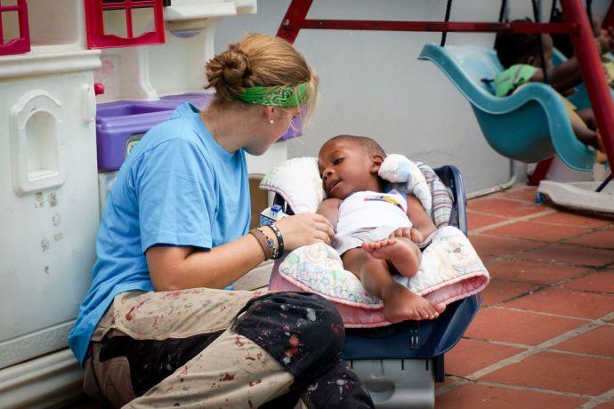 Trinidad & Tobago: Port of Spain, Trinidad  Tobago :: Logos Hope crewmember plays with a child who has cerebral palsy. More Info