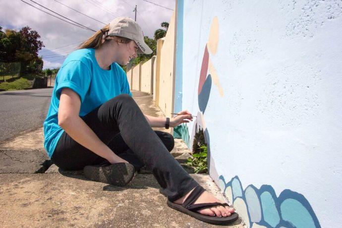 Trinidad & Tobago: Scarborough, Trinidad  Tobago :: Amy Strickland (US) paints a mural at a childrens home. More Info