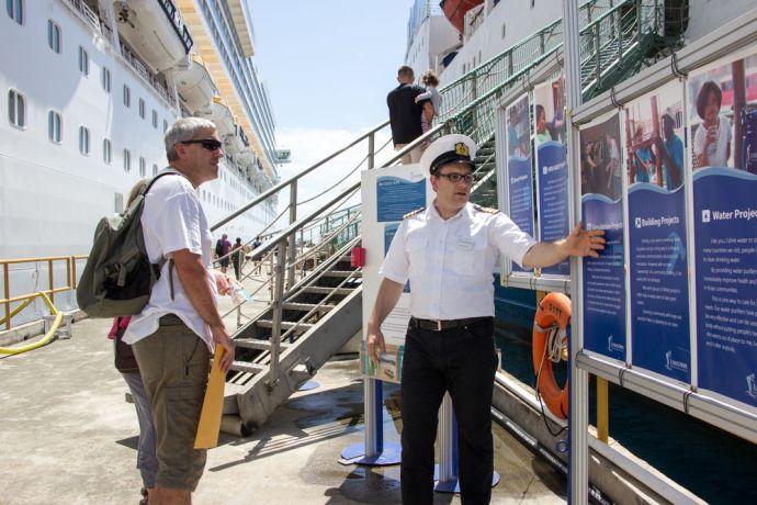 Trinidad & Tobago: Scarborough, Trinidad  Tobago :: Christoph Nicolai (Germany) explains about the work of Logos Hope to a cruise ship passenger. More Info