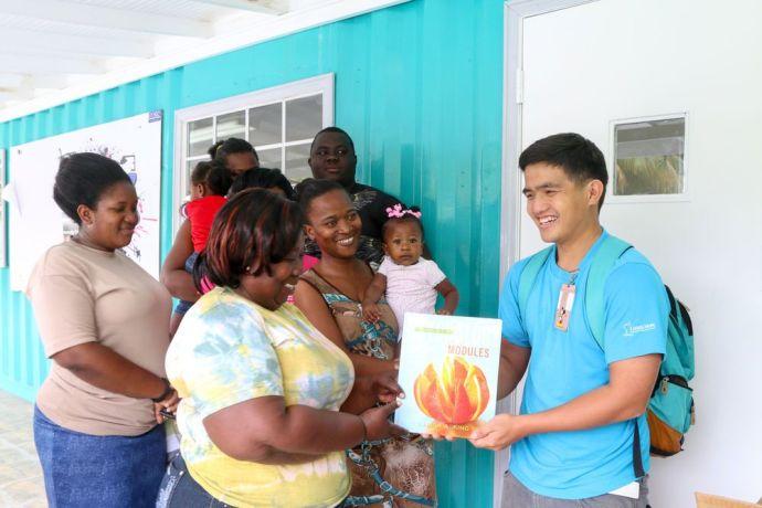 Trinidad & Tobago: Scarborough, Trinidad  Tobago :: Irawin Warinsirikul (Thailand) donates books to a youth club. More Info