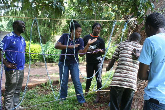 Zimbabwe: Crossing the cobweb - MDT students discuss strategies on how to cross  a spiders web in team building session More Info