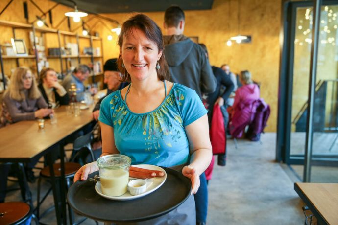 Switzerland: Hope for Zurich-Team leader Debora serves food to visitors in a cafe owned by a local church. Photo by Anja B. More Info