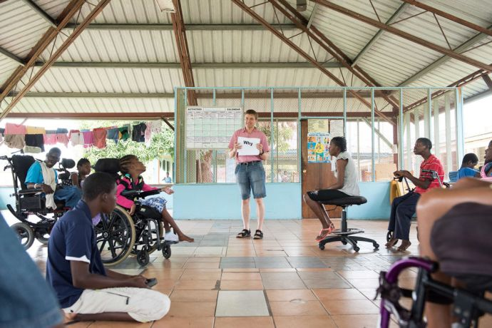 Jamaica: Kingston, Jamaica :: Stein Nilsen (Norway) explains a drama to children with disabilities at a Mustard Seed Communities care facility. More Info