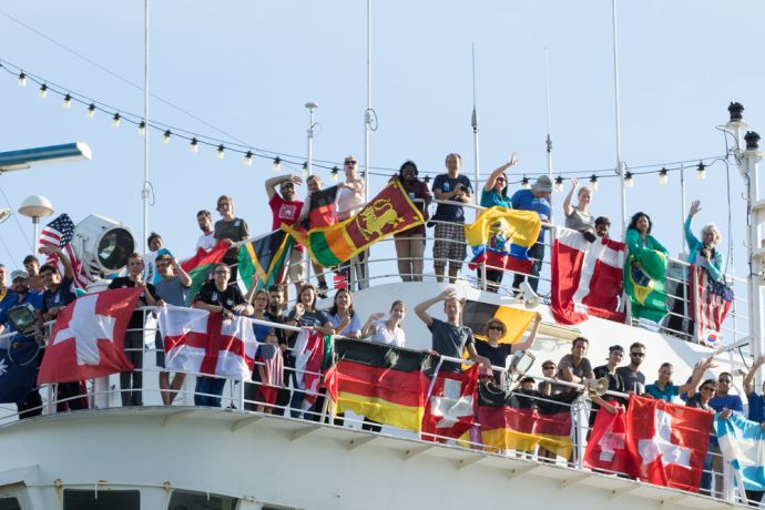 Jamaica: Montego Bay, Jamaica :: Crewmembers wave during Logos Hopes arrival to Montego Bay. More Info
